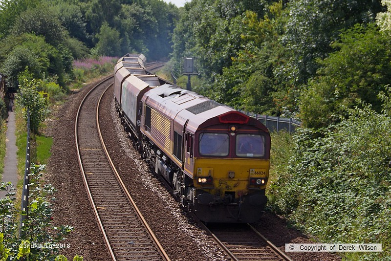 180723-003  DB Cargo class 66/0 No. 66024 is seen from Princes Street footbridge, Mansfield, on the Robin Hood Line, with five HTA hoppers in tow for 'cut & shut' mods, running as 4Z20, 13:34 Toton North Yard - Shirebrook, W.H. Davis.