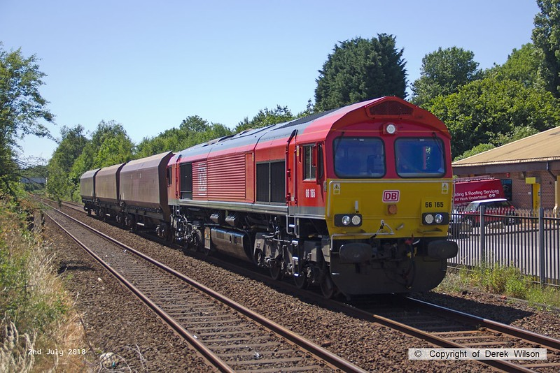 180702-003  DB Cargo class 66/0 No. 66165 is seen passing Tenter Lane, Mansfield, powering 4Z20, 13:34 Toton North Yard - Shirebrook, W.H. Davis. In tow are three HTA coal hoppers for 'cut & shut' modification.
