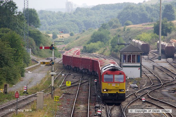 180713-095  DB Cargo class 60 No. 60059 Swinden Dalesman is captured pulling away from the Cemex sidings at Peak Forest with train 6F07, the 14:18 to Dallam Freight Depot