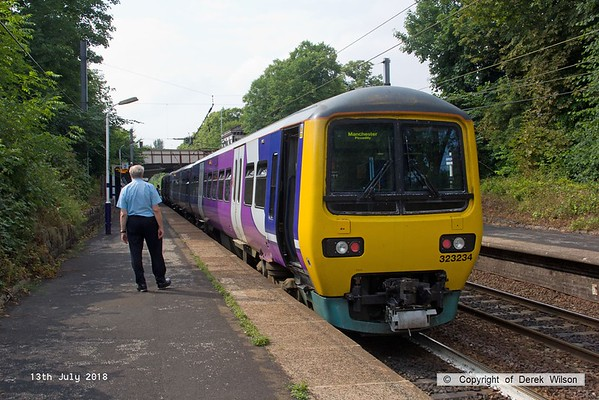180713-117  Northern class 323 EMU No. 323234 calls at Davenport with 2H02, the 16:21 Hazel Grove - Manchester Piccadilly.