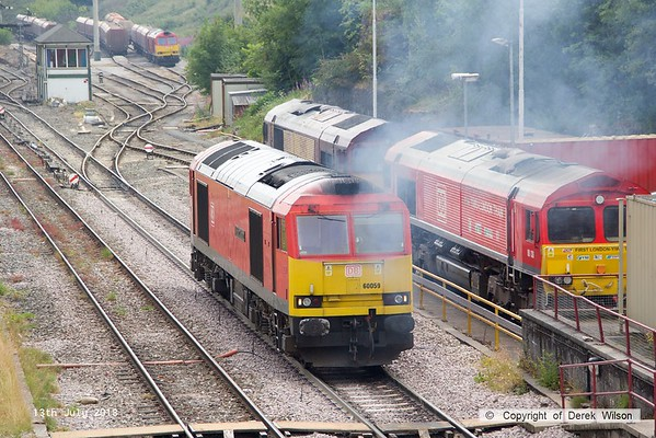 180713-090  DB Cargo class 60 No. 60059 Swinden Dalesman is captured at Peak Forest as it heads to the Cemex siding to couple up to a rake of loaded MMA bogie box wagons.