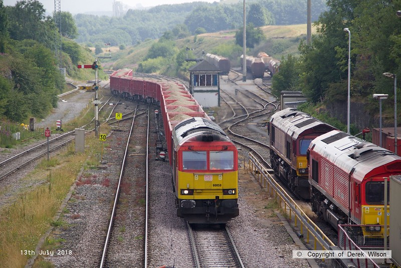 180713-096  DB Cargo class 60 No. 60059 Swinden Dalesman is captured pulling away from the Cemex sidings at Peak Forest with train 6F07, the 14:18 to Dallam Freight Depot