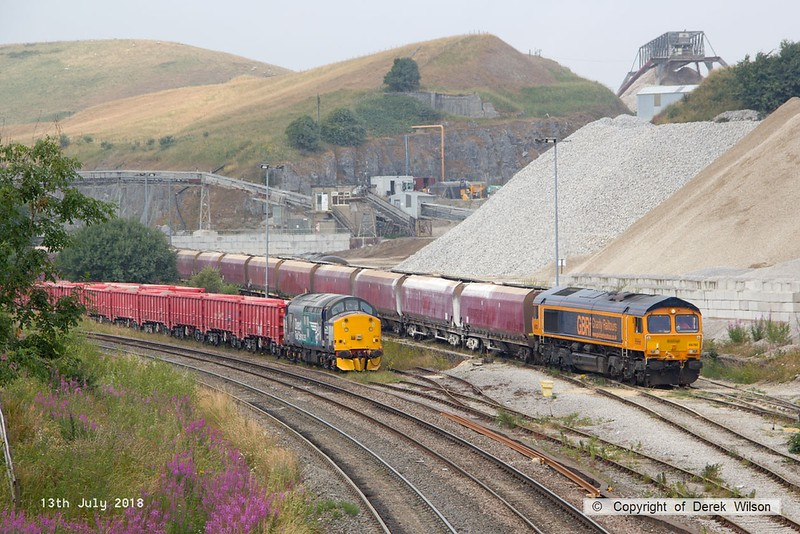 180713-089  GB railfreight class 66/7 No. 66782 is seen at Peak Forest, propelling a rake of former EWS hoppers into Dove Holes quarry.  To the left is DRS class 37/7 No. 37716 which is on hire to Victa Railfreight, for shunting duty at the quarry.