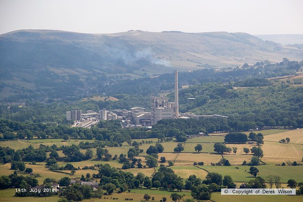 180714-001  Lafarge cement works at Hope, near Castleton, Derbyshire, with three rakes of cement tanks visible to the left of the complex. Captured from a high vantage point during a nine mile circular walk with my two sons, starting & finishing in Castleton.