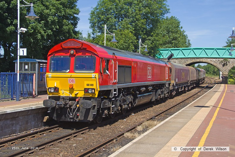 160625-011  DB Cargo class 66/0 No. 66149  is seen propelling seven hoppers through Shirebrook station, train 4Z18, 10:00 Belmont Down Yard, Doncaster - Shirebrook, W.H. Davis.