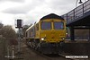 1803013-006  GB Railfreight class 66/7 No. 66742 Port of Immingham Centenary 1912 - 2012 is captured pulling in to platform three at Mansfield Woodhouse, with East Midlands Trains route learner 0H03, 10:50 Codnor Park Junction - Mansfield Woodhouse.