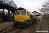 1803013-007  GB Railfreight class 66/7 No. 66742 Port of Immingham Centenary 1912 - 2012 is captured in platform three at Mansfield Woodhouse, about to depart with East Midlands Trains route learner 0H04, 11:22 Mansfield Woodhouse - Nottingham Eastcroft.