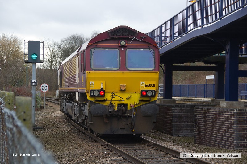 180308-007  Ex DBC class 66 no. 66008, which is now part of the GB Railfreight fleet is seen pulling away from platform three at Mansfield Woodhouse, with East Midlands Trains route learner 0H02, 10:15 Mansfield Woodhouse - Codnor Park Junction. 66008 is one of a batch of ten 66's purchased by GB and is to be renumbered 66780.
