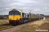 180323-012  GB Railfreight Class 66/7 No. 66789 repainted in a version of BR large logo livery is captured passing Rushey Sidings with train 4R71, 14:28 Cottam Power Station - Immingham H.I.T. This is ex DB Cargo 66250, one of ten examples purchased by GBRf.