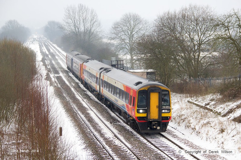 180303-001  East Midlands Trains class 158 unit No 158854 & a unidentified class 156 are seen passing Westhouses, near Alfreton with 1R66, the 06:53 Norwich - Liverpool Lime Street.