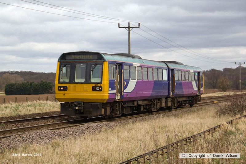 180323-005  Northern class 142 Pacer unit No. 142049 passes Rushey Sidings with 2R15, the 11:25 Lincoln - Adwick.