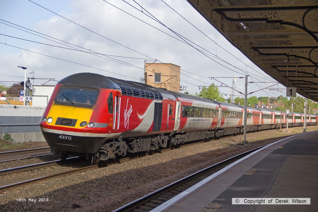 180510-015  Virgin East Coast class 43 No. 43312 is captured passing through Retford with 1A15, the 07:34 Harrogate - London King's Cross.