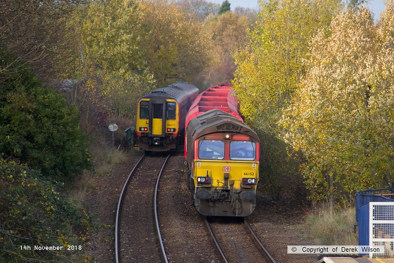 181114-008  DB Cargo class 66/0 No. 66152 Derek Holmes - Railway Operator is seen passing through Mansfield Woodhouse, powering train 3J89, 05:00 Stapleford & Sandiacre - Toton T.M.D.. In tow are seven modified bogie hoppers. Heading the opposite way is East Midlands Trains classs 156 unit No. 156415 with 2W12, the 12:26 Nottingham - Worksop.