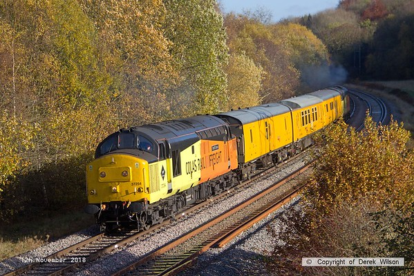 181112-007  A Network Rail test train powered 'top & tail' by 37116 & 37254 Cardiff Canton is captured near Boughton Junction, on the High Marnham Test Track, seen during calibrating. Of note is that the fishplates on the far line have been painted white, this is in preparation for a High Output Track Renewal Train that is expected to relay this section of track in January.