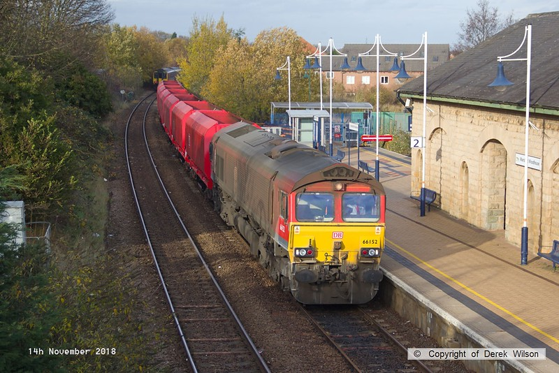 181114-010  DB Cargo class 66/0 No. 66152 Derek Holmes - Railway Operator is seen passing through Mansfield Woodhouse, powering train 3J89, 05:00 Stapleford & Sandiacre - Toton T.M.D.. In tow are seven modified bogie hoppers.