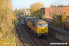 181110-011  Colas Rail Freight class 56's No's 56105 & 56090 are seen in top & tail mode, powering RHTT 3J89, 05:00 Stapleford & Sandiacre - Toton T.M.D.. Captured passing Prince's Street footbridge, Mansfield.