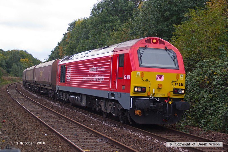 181003-003  DB Cargo class 67 No. 67028 is seen near Princes Street footbridge, Mansfield, powering 4Z20, 12:54 Toton North Yard - Shirebrook, WH Davis. In tow are four HTA hoppers for the 'cut & shut' modification at WH Davis's. Davis's asked for just one to be delivered, but DBC sent four, of which three were returned to Toton!!