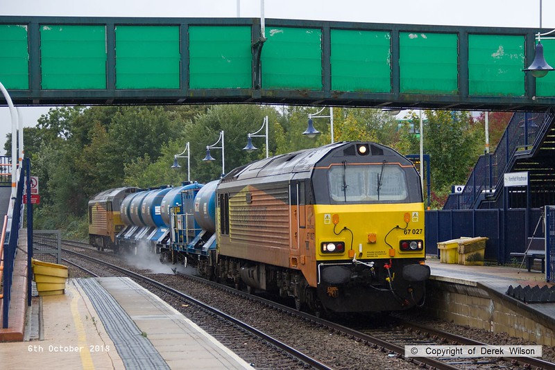 181006-002  Colas Rail Freight class 67's No's 67027 Charlotte & 67023 Stella are captured passing through Mansfield Woodhouse station, powering RHTT 3J89, 05:00 Stapleford & Sandiacre - Toton T.M.D.
