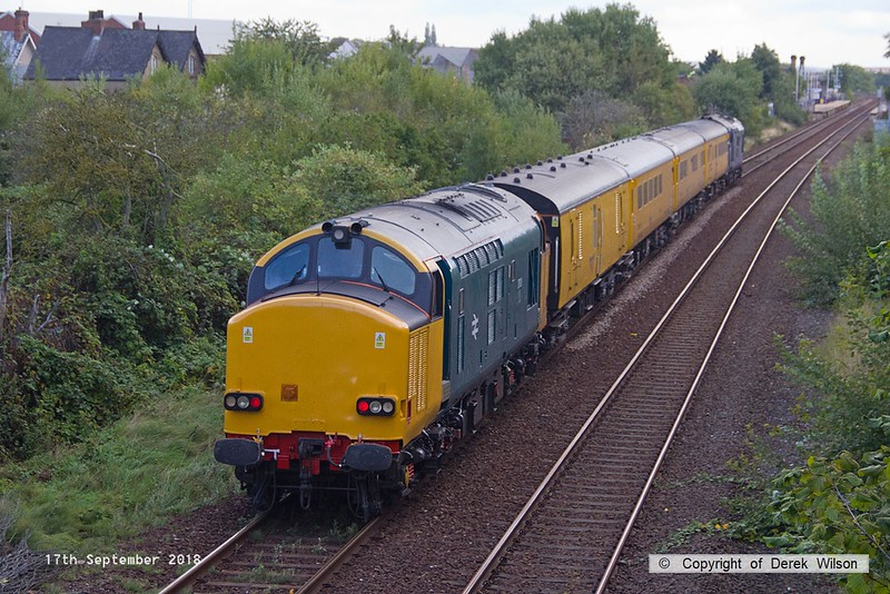 180917-004  Network Rail test train 1Q64, 09:11 Burton Wetmore Sidings - Leeds Neville Hill T.&R.S.M.D. is seen passing Tenter Lane, Mansfield, powered 'top & tail' by 37612 in unbranded DRS blue, and 37610 (nearest) in non-standard blue. Both are on hire to Colas Rail Freight, 37610 having recently returned to main line action after a long absence.