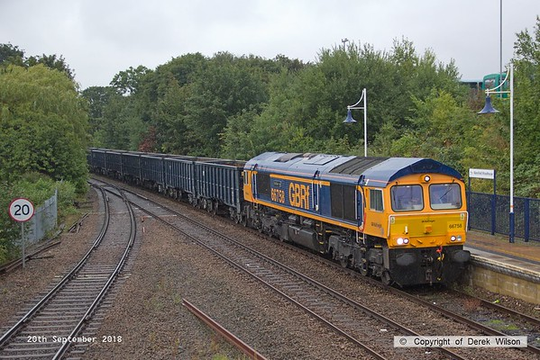 180920-002  GB Railfreight class 66/7 No. 66758 was named 'The Pavior' at a ceremony at Tarmac's Harper Lane site in Radlett on 14th September. It is seen here, six days later, passing through a wet Mansfield Woodhouse with train 6E89, 10:16 Wellingborough up TC - Rylstone.