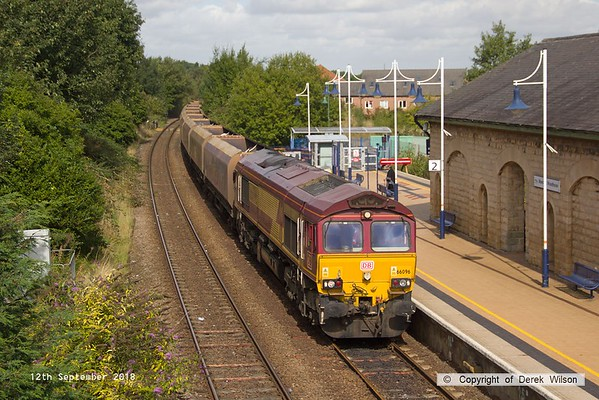 180912-002  DB Cargo class 66/0 No. 66096 is seen passing through Mansfield Woodhouse, powering train 4Z21, 12:00 Worksop Down Yard - Bescot Down Side. The HTA hoppers have been in store at Worksop & are most likely for the 'cut & shut' modifications. The work to convert 110 hoppers is being shared between Axiom Rail at Stoke & W.H. Davis at Shirebrook.