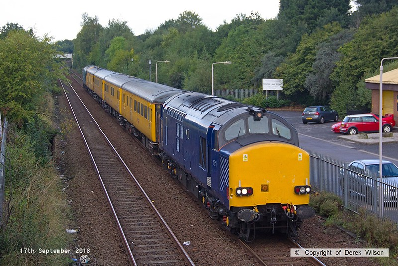 180917-003  Network Rail test train 1Q64, 09:11 Burton Wetmore Sidings - Leeds Neville Hill T.&R.S.M.D. is seen passing Tenter Lane, Mansfield, powered 'top & tail' by 37612 in unbranded DRS blue, and 37610 in non-standard blue. Both are on hire to Colas Rail Freight, 37610 having recently returned to main line action after a long absence.