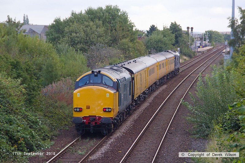 180917-006  Network Rail test train 1Q64, 09:11 Burton Wetmore Sidings - Leeds Neville Hill T.&R.S.M.D. is seen passing Tenter Lane, Mansfield, powered 'top & tail' by 37612 in unbranded DRS blue, and 37610 (nearest) in non-standard blue. Both are on hire to Colas Rail Freight, 37610 having recently returned to main line action after a long absence.
