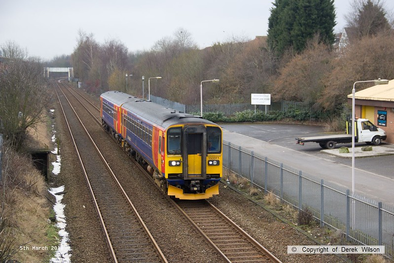 180305-001  East Midlands Trains class 153 unit's No's 153311 & 153374 are seen passing Tenter Lane Mansfield, forming 2H09, the 10:55 Nottingham - Mansfield Woodhouse. The snow at the trackside is all that's left of what was deposited last week by 'The Beast from the East' & 'Storm Emma'.