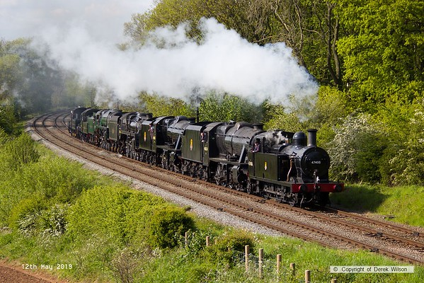 190512-080  Highlight of the day was the cavalcade, consisting of all seven loco's that were in steam. Led by the Jinty 47406 which provided a nice plume of exhaust over the ensemble, the rest, in order were 48624,48305, 73156,92214,46521 & 78018. Captured passing Kinchley Lane, running as 0C41, 16:20 Loughborough - Rothley Brook,, although somewhat late, due to the Jinty & 48624 running late back to Loughborough. There can't be many heritage lines, if any, that could put on a show like this, fantastic!
