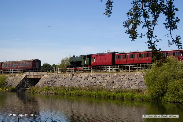 190824-001  Hunslet austerity 0-6-0ST No. 3883 Lord Phil is captured crossing Butterley reservoir during the Midland Railway's vintage trains event.