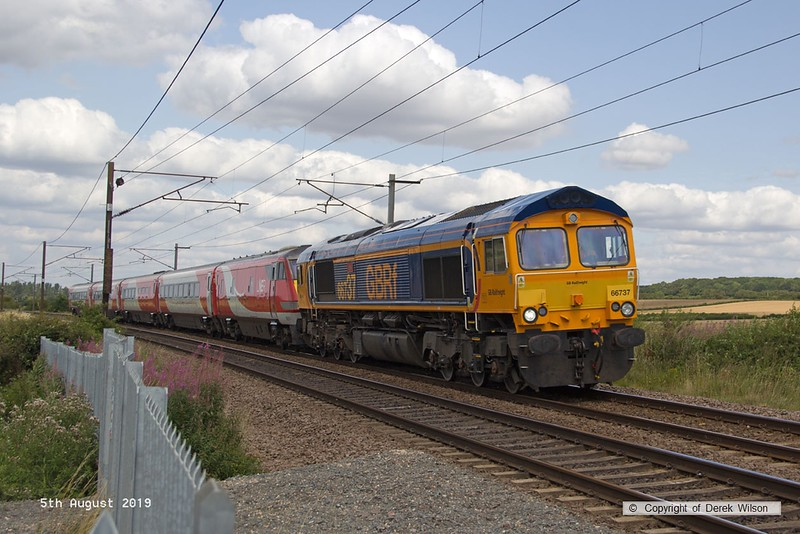 190805-014  GB Railfreight class 66/7 No. 66737 Lesia is seen passing Eaton Lane on the East Coast Main Line, powering train 5Z90, 12:46 Worksop Down Reception - Bounds Green T. & R. S. M. D. In tow is East Coast DVT No. 82217 and coaches 11328, 10310, 12320, & 12218 (from set B28) which have been removed from store at Worksop yard.