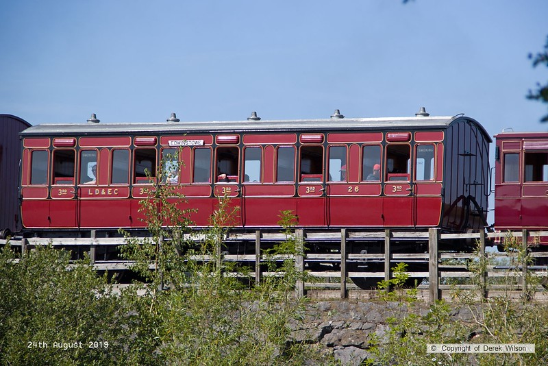 190824-020  Lancashire Derbyshire & East Coast Railway coach No. 26, seen crossing Butterley reservoir during the vintage trains weekend. The LD&ECR only managed to reach as far as Chesterfield, to the west, and Pyewipe junction, Lincoln, to the east, and after about ten years of operation (1897 - 1907) was taken over by the Great Central Railway. The only significant section that remains is the stretch that leaves the Robin Hood Line at Shirebrook junction and continues as far as the former power station at High Marnham. Since the closure of Thoresby colliery the line has no regular traffic but is used to access the High Marnham Test Track which starts at Thoresby colliery junction & continues through to Marnham, with the main headquarters at Lodge Lane, Tuxford.