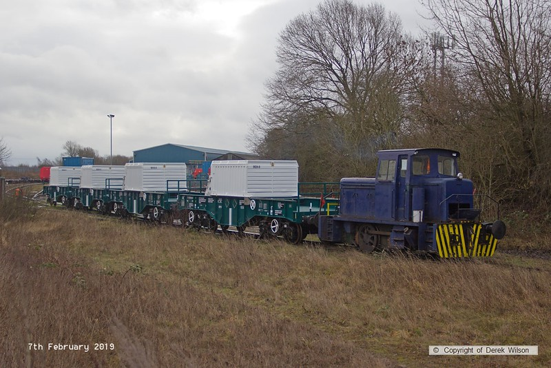 190207-011  Andrew Barclay 0-4-0DH, works No. 499 is captured dragging four new nuclear flask wagons out of Davis's yard, for handing over to Direct Rail Services.