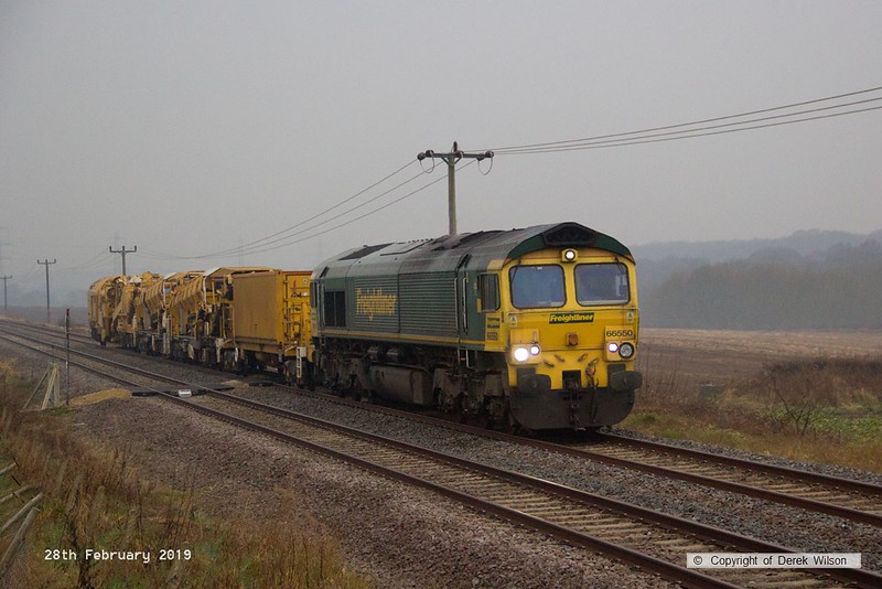 190228-002  Freightliner class 66/5 No. 66550 is seen passing Edwinstowe foot crossing on the former LDECR, on a rather gloomy morning, powering train 6X04, 05:53 Stapleford & Sandiacre C.C.E. Siding - Thoresby Colliery Junction. In tow are a support vehicle, two Octopus wagons and a Matisa D75 undercutter.