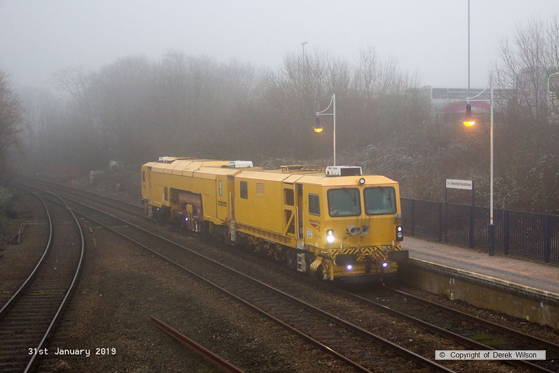 190131-003  Network Rail track tamper No. DR 73118 running as 6U52, 09:00 Crewe P.A.D. - Thoresby Colliery Junction, seen passing through Mansfield Woodhouse on the Robin Hood Line.