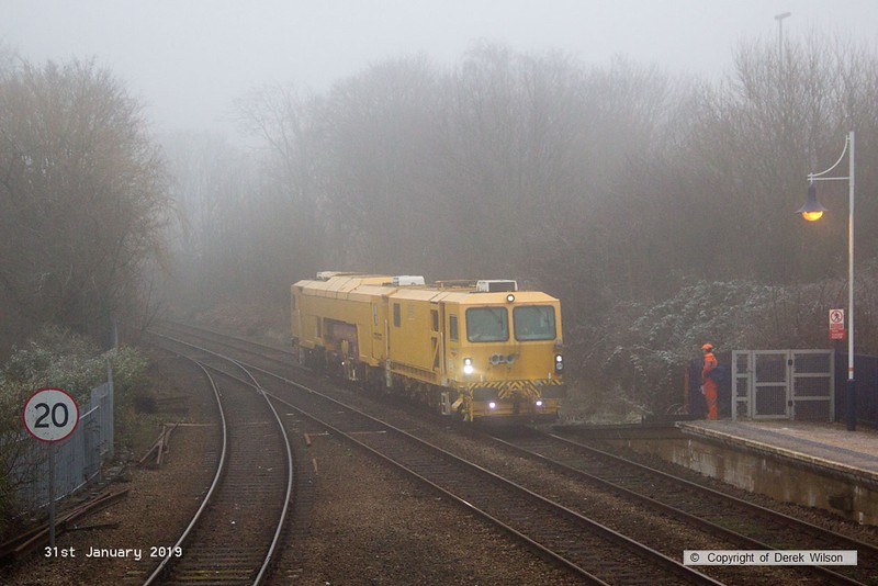 190131-001  Network Rail track tamper No. DR 73118 running as 6U52, 09:00 Crewe P.A.D. - Thoresby Colliery Junction, seen passing through Mansfield Woodhouse on the Robin Hood Line.