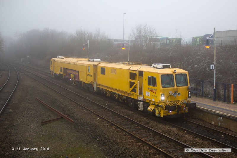 190131-005  Network Rail track tamper No. DR 73118 running as 6U52, 09:00 Crewe P.A.D. - Thoresby Colliery Junction, seen passing through Mansfield Woodhouse on the Robin Hood Line.