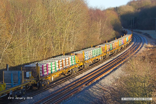190123-032  A colourful view, a rake of loaded bogie sleeper carriers in the consist of 6X08, 10:30 Toton North Yard - High Marnham (VSTP). Seen near Boughton Junction.