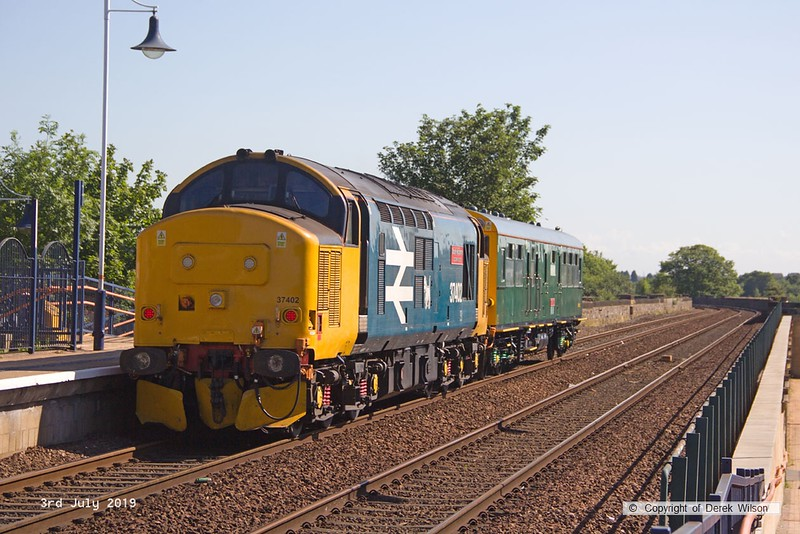 190703-006  Direct Rail Services class 37/4 No. 37402 Stephen Middlemore 23.12.1954 - 8.6.2013 is captured propelling observation saloon 975025 Caroline through Mansfield, heading to platform three at Mansfield Woodhouse. Running as 2Z02, 08:35 Derby - Derby.