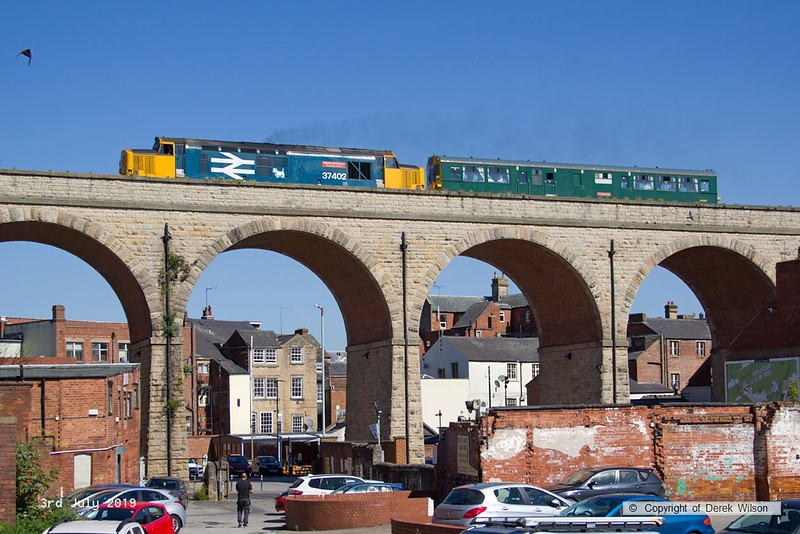 190703-013  Direct Rail Services class 37/4 No. 37402 Stephen Middlemore 23.12.1954 - 8.6.2013 with  observation saloon 975025 Caroline, is captured crossing the 15 arch viaduct at Mansfield with 2Z02, 08:35 Derby - Derby.