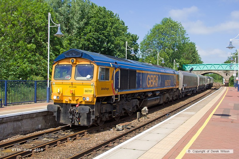190627-001  GB Railfreight class 66/7 No. 66767 propelling train 4D90, 11:45 Doncaster Down Decoy - Shirebrook, WH Davis through Shirebrook station, towards Davis's branch.