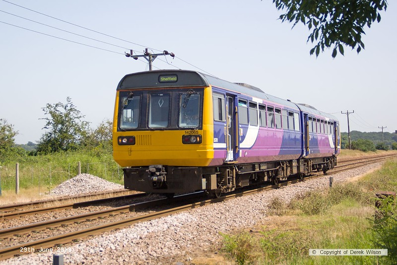 190629-005  Northern class 142 pacer unit No. 142055 passing Rushey Sidings with 2H00, the 11:14 Cleethorpes - Sheffield.