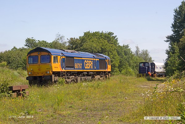 190627-018  GB Railfreight class 66/7 No. 66767 waits on Davis's exchange siding whilst Barclay 0-4-0DH No. 499 transfers more modified hoppers onto the end of the branch line..