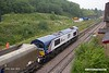 190624-041  GB Railfreight class 66/7 No. 66780 The Cemex Express  and sporting Cemex livery is seen arriving at Peak Forest with 4M11, 10:01 Washwood Heath - Peak Forest, Cemex.