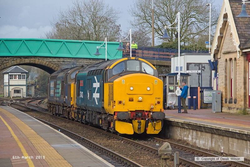 190306-010  Direct Rail Services class 37's No's 37402 Stephen Middlemore 23.12.1954 - 8. 6. 2013, and 37425 Concrete Bob are captured arriving at Shirebrook, running as 0Z37, 12:00 Norwich Crown Point T.&R.S.M.D. - Shirebrook, WH Davis. These were stabled overnight on Davis's branch line, and left the following day with eight new FNA nuclear flask wagons.