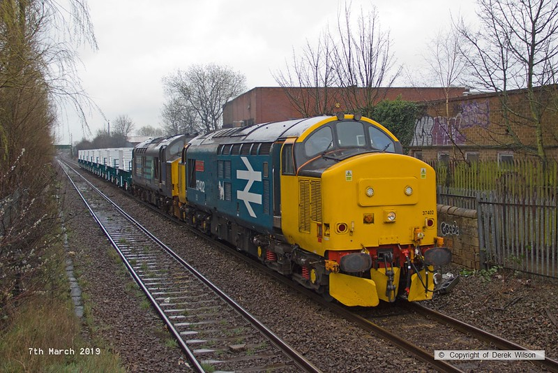 190307-003  Direct Rail Services class 37's No's 37402 Stephen Middlemore 23.12.1954 - 8. 6. 2013, and 37425 Concrete Bob are captured passing Princes Street footbridge at Mansfield, powering train 6Z37, 12:10 Shirebrook, WH Davis - Crewe Coal Sidings. In tow are eight new nuclear flask wagons, type FNA.