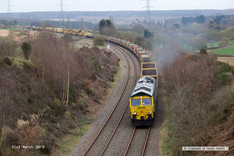 190321-003  Freightliner class 66/5 No. 66525 is captured heading towards Welbeck Junction, leading 6X04, 16:00 Thoresby Colliery Junction - Doncaster, Belmont Down Yard. In tow is track renewal system four (TRS4) with 66515 bringing up the rear. The renewal train had spent the last three weeks on the High Marnham Test Track.