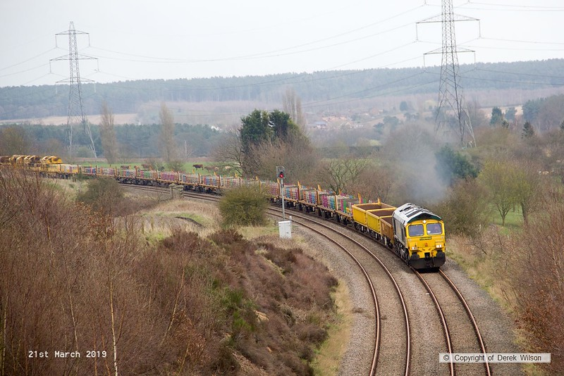 190321-001  Freightliner class 66/5 No. 66525 is captured heading towards Welbeck Junction, leading 6X04, 16:00 Thoresby Colliery Junction - Doncaster, Belmont Down Yard. In tow is track renewal system four (TRS4), out of sight at the rear is 66515.