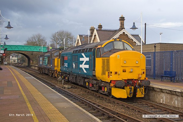 190306-012  Direct Rail Services class 37's No's 37402 Stephen Middlemore 23.12.1954 - 8. 6. 2013, and 37425 Concrete Bob are captured arriving at Shirebrook, running as 0Z37, 12:00 Norwich Crown Point T.&R.S.M.D. - Shirebrook, WH Davis. These were stabled overnight on Davis's branch line, and left the following day with eight new FNA nuclear flask wagons.