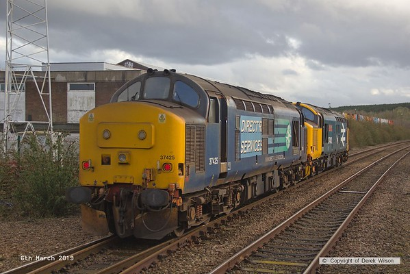 190306-013  Direct Rail Services class 37's No's 37402 Stephen Middlemore 23.12.1954 - 8. 6. 2013, and 37425 Concrete Bob are captured arriving at Shirebrook, running as 0Z37, 12:00 Norwich Crown Point T.&R.S.M.D. - Shirebrook, WH Davis. These were stabled overnight on Davis's branch line, and left the following day with eight new FNA nuclear flask wagons.
